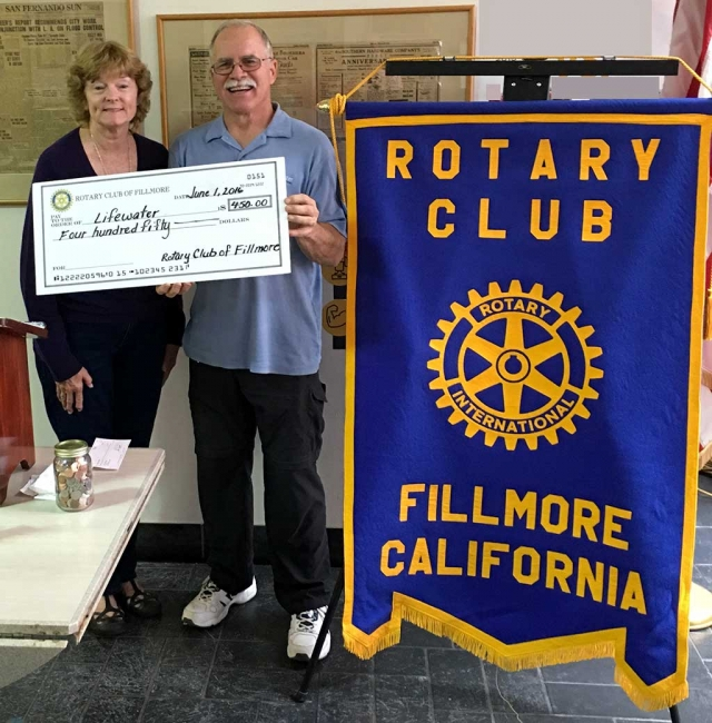 Rotary Makes Donation To Lifewater. Martha Richardson program chair, presented Rod Thompson of Lifewater with a donation check for $450. Lifewater is a Christian organization that drills wells, educates and trains people in deprived counties, so they will have clean water and healthier lives.