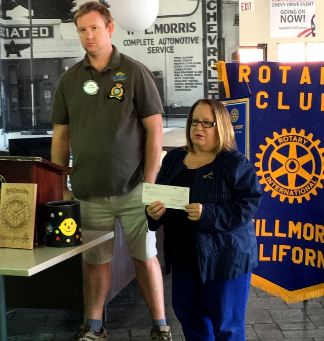 Fillmore Rotary Club donated $1,000 to the Boys & Girls Club Summer Camp. Pictured is Rotary President Andy Klittich presenting Jan Marholin of the Boys & Girls Club, who expressed her thanks and related what the camp means to the students. Photo courtesy Martha Richardson.