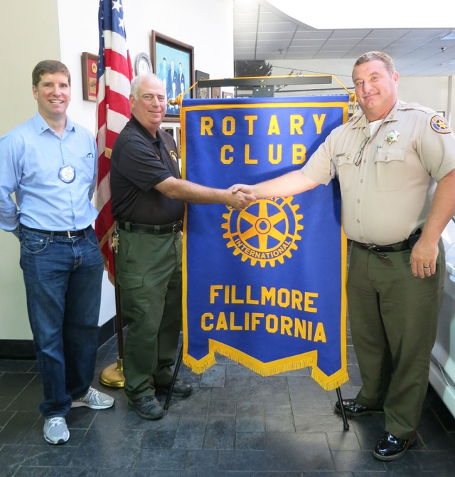 Jerry Peterson is inducted into the Rotary Club of Fillmore. Pictured are Sean Morris, President, Jerry Peterson and Dave Wareham, Fillmore Chief of Police.