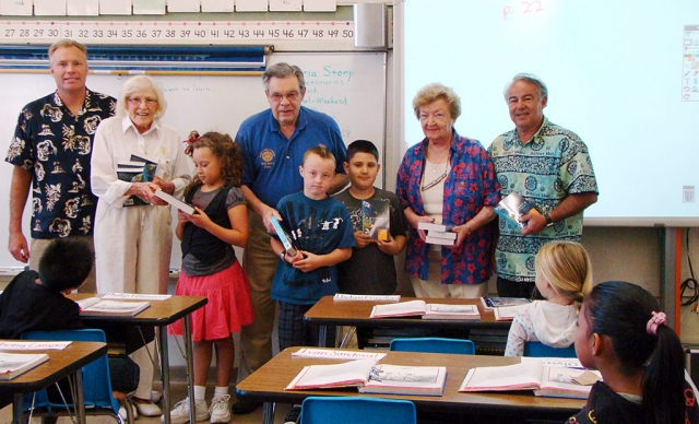 The Fillmore Rotary Sun Risers each year give third grade students a brand new dictionary to keep. The teachers are very appreciative of this as they are a definite asset when the students are working on their academic studies. Pictured are: Scott Olson –third grade teacher at San Cayetano, Rotarians: Ruth and Don Gunderson, Marge Le Bard and Tim Gurrola. Students pictured are Hannah, Dylan and Ivan.