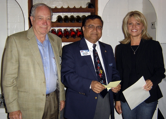 Shown (l-r) are Bill Shiells, President, Anil Garg, District Governor and Diane Torrence new member of noontime Rotary.