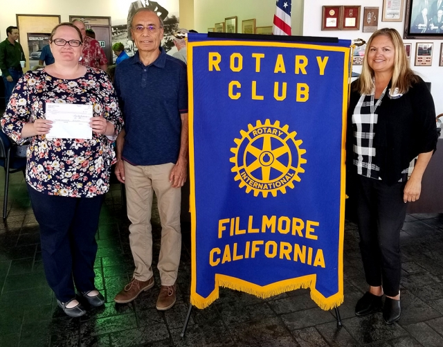 The Rotary Club of Fillmore made a $150 donation to Grad Nite Live on behalf of Rotary 5K Team Challenge winner Pro Body Fitness. Pictured (l-r) are Alicia Hicks who received the check on behalf of Grad Nite Live, Race Director Joe Aguirre, and President Ari Larson. Photo courtesy Martha Richardson.