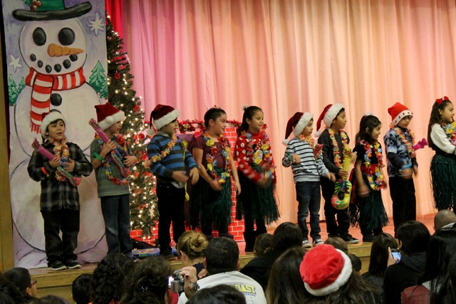 Santa and his helpers got into the Christmas groove at the San Cayetano Christmas program last week.
