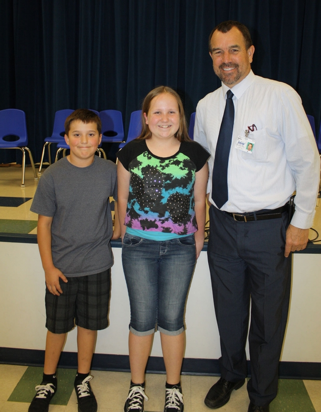 "(l-r) Runner-up Phillip Cervantes, Champion Emma Myers, with MV Principal John Wilber. The audience was on the edge of their seats as 28 students competed last week to earn the title of Mountain Vista School Spelling Bee Champion.  Competition was intense between the 3rd, 4th, and 5th graders through five rounds. Finally, after eight rounds Emma Myers won with the championship word ""full-fledged.""  Phillip Cervantes is runner-up.  The next stage in the competition is the Ventura County Bee held March 7 at California State Channel Islands University."