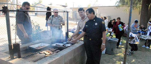 The Fillmore Fire and Sheriff Departments barbecued lunch for the students at Sierra High School on Friday, December 11th. Pictured (l-r) is Sheriffs Sgt. Dave Wareham, Deputy Jerry Petersen, Captain Tim Hagel, and Fillmore Fire Chief Rigo Landeros.