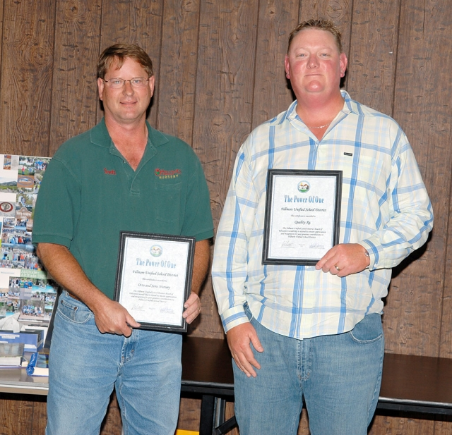 Two Fillmore Businesses were honored at Tuesday night's FUSD Board meeting: Otto & Sons Nursery, and Quality Ag Inc. Both businesses helped prepare for the coming FHS 2010 graduation. Left is Otto & Sons owner Scott Klittich, right is Mike Richardson, with Quality Ag Inc., both holding their award plaques.