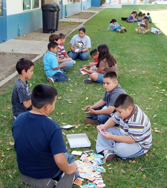 A group of 4th and 5th grade students at San Cayetano School have been working twice a week with students from all four of the first grade classes. The 4th and 5th graders have been working on skills such as letter names and sounds, compound words, sight words, addition, and oral sentences.