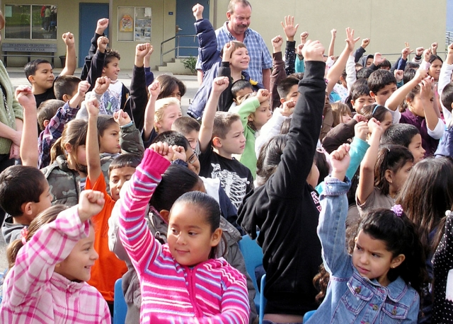 Piru students pump fists to simulate heart beats.