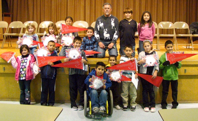 On Monday, December 7, 2009, San Cayetano School recognized good citizenship and character at their Peacebuilder Assembly for the month of December. Pictured is Francisco Garcia, of CSUCI, who spoke to the students about how to be a good citizen.