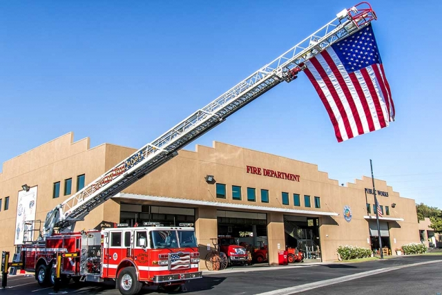 Fillmore Fire Department held a Memorial for the 15th Anniversary of 911 this past Sunday at 6:30am by flying an American flag attached to the top of the ladder and served refreshments to the community. Photo by Bob Crum.