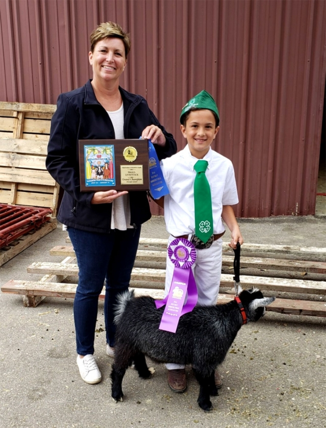 Pictured is Ethan Zavala of Sespe 4H who won Supreme Grand Champion, with his Registered Pygmy Goat at this year's Ventura County Fair Small Livestock Show. Pictured with Ethan is project leader Kerrie Allen.