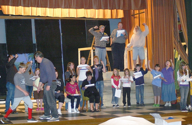 Matthew Lindsey and the cast of Alice in Wonderland  take direction from Stephen Burhoe for Sespe Players' next production in the Sespe Auditorium to begin April 23rd.