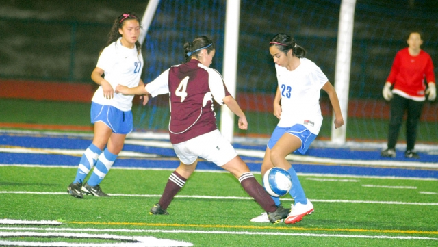 Alexis Beccera #23 and Jasmine Medina work together to keep the ball away from the goal.