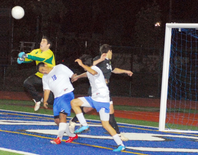 Israel Dominguez #18 played a tough game against Oak Park. The goalie was able to defend the goal.