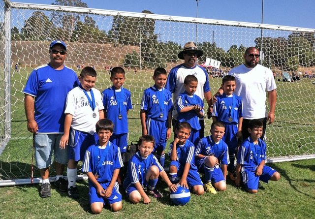 In the Thousand Oaks Memorial Day Tournament, Fillmore boys U-8 team played a U-9 team and took home second place. (l-r) (bottom row) Jathan Magana, Adrian Vasquez, Mathew Magana, Julio Negrete, Diego Alcaraz, (top row) Ivan Becerra, Angel Castorena, Armando Manriques, Alfredo Cardenas, and Dante Reyes. (not pictured) Sebastian Navarrete. Coaches are Joe, Damian and Javier.
