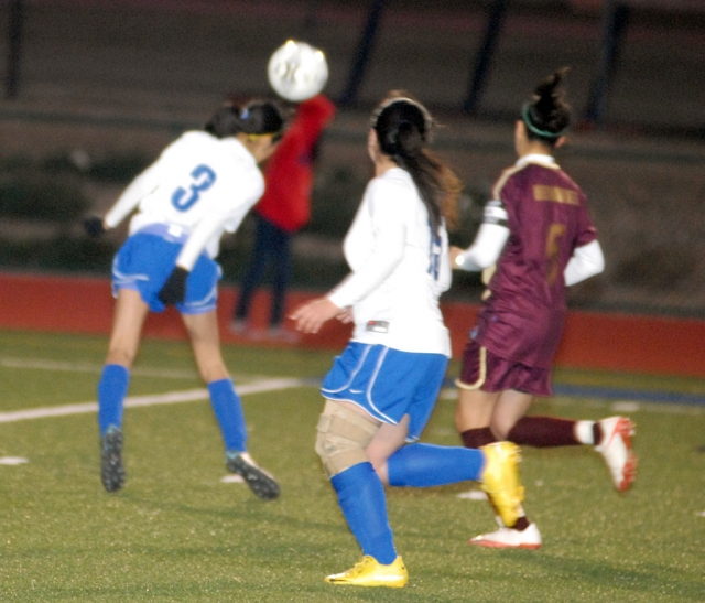 Gaby Santa Rosa #3 uses her head to move the ball on the field.