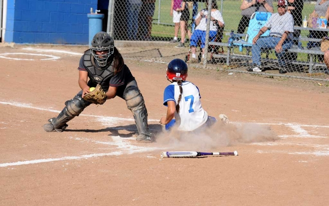 (above) Flashes varsity player sliding in safe at home plate to score for Fillmore. The Fillmore Lady Flashes J.V. and Varsity took on Santa Paula last Thursday. After a hard battle for both J.V. and Varsity, Fillmore lost to Santa Paula. Final Scores: J.V. 5-6, Varsity 4-5.