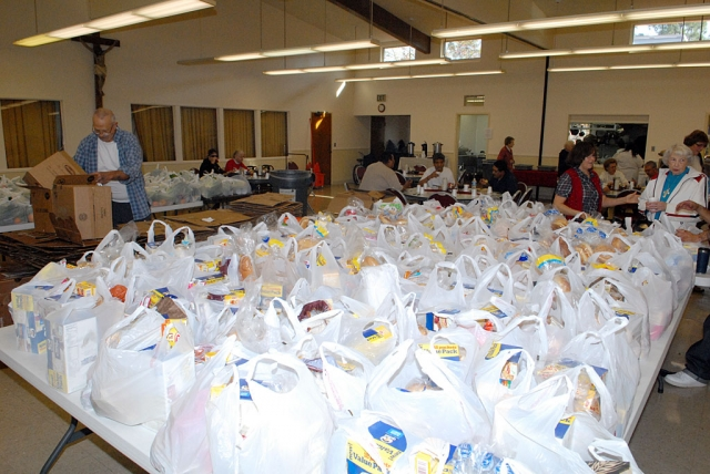 The St. Francis of Assisi food bank collects groceries for distribution.