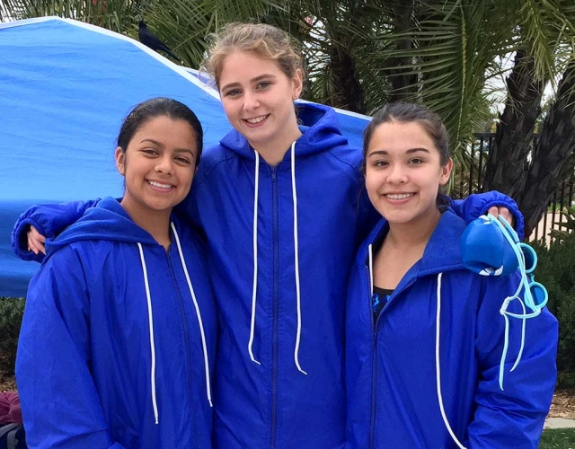 Congratulations to Katrionna Furness (pictured above center), Fillmore Girls Swim Team member. Kat, a junior, broke two FHS school records at Friday's home meet: in the 200 Freestyle her time was 2.07.8 (going into the event with a 2.08), qualifying for CIF consideration—the existing record was 2.12. In the 100 Backstroke her time was 1.04.2 (going into the event with 1.03.59), qualifying for auto CIF—the existing record was 1.17. Kat also qualified for auto CIF with a 26.2 in her 50 Freestyle at the VCS Swim Champs Prelims on Tuesday at the VC Aquatics Center. She will swim in the finals on Friday, placing 4th overall at the prelims. And congratulations to Daisy Santa Rosa and Reanne Guerra for their participation in the Prelims. These three girls were to participate in a relay at the prelims which had to be scratched due to a team member injury.