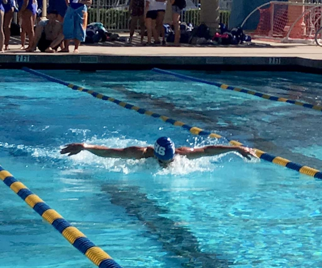 Flashes JJ Gonzalez winning the 100 yd. Butterfly relay at Trinity Classical on March 15th.