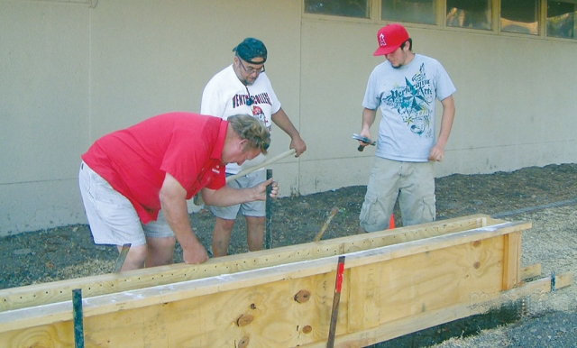 "Above, Harold Foy (l), Owner , Fillmore Building Supply, Mike Munoz (center), father of Roberto Munoz and Roberto (Eagle Scout candidate) laying concrete in forms for the bench on the memorial site. June 2012. Pictured left, a 12x20"" plaque will be installed on the front face of the concrete bench by Harold Foy in August 2012. The bronze plaqye was fabricated in New York and is provided by the Grtiz-MacKenzie Family to the project."