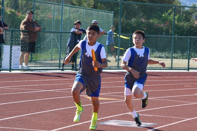 (l-r) Emilio Magana and Jimmy Carlos Midget Boys 4X100m relay first place with 59.99 sec.