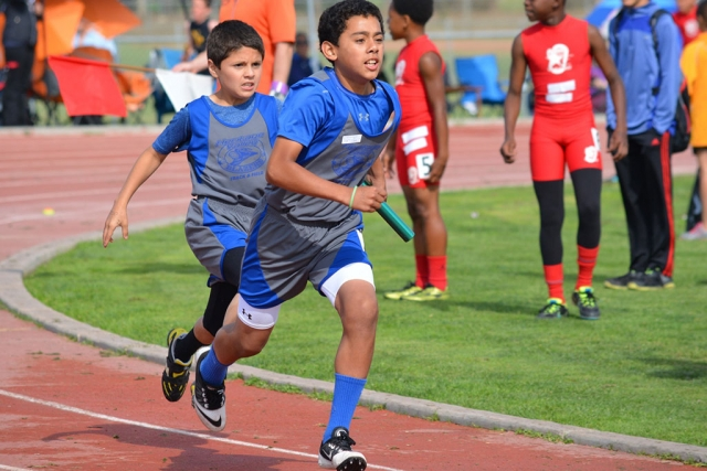 3rd Place Midget Boys 4X100m Relay team (59.99) (left) Richard Vega (right) Joshua Morales.