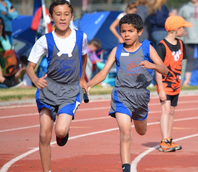 Bantam 4 letter x 100m Relay team left Stevan Martinez right Carmelo Grandison.