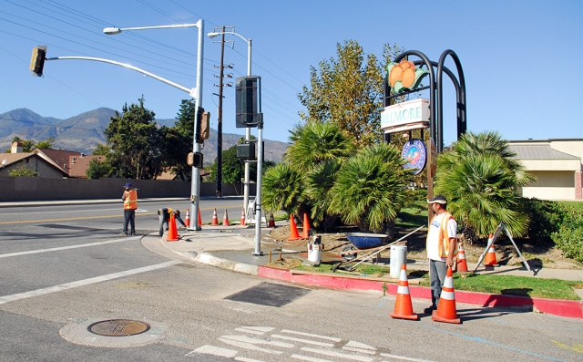 The new traffic signal at the corner of River and A Streets is almost ready for operation. Workers can be seen finishing the electrical work and testing.