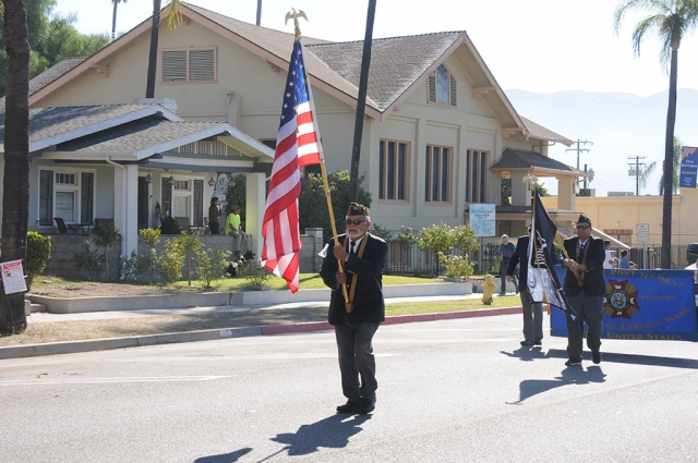 "On Monday, November 11th at 10am on Central Avenue, Veteran's and their families were invited to participate in a Veteran's Day Parade, ceremony and barbecue lunch. Veterans and their families were also invited to march in the parade, as well as ride in one of the classic cars provided by Sespe Creek Car Events. Pictured is a portion of Fillmore Boy Scouts Troop 406 marching in this year's parade carrying a banner listing the names of all the Veterans from the Fillmore, Piru and surrounding areas who gave their lives for their country. Immediately after the parade at the Veterans Memorial Building a ceremony ""Honoring Our Hero's"" was held to recognize those who have served. Also recognized was the Grand Marshal John Munoz, who served in the US Army from 1966 – 1968."