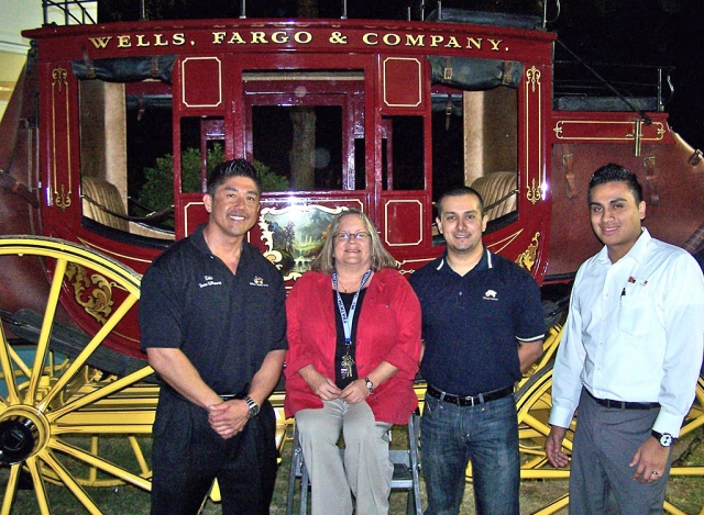 Jan Marholin, principal of San Cayetano, with Wells Fargo Team Members (from left to right) Eric Iree - Branch