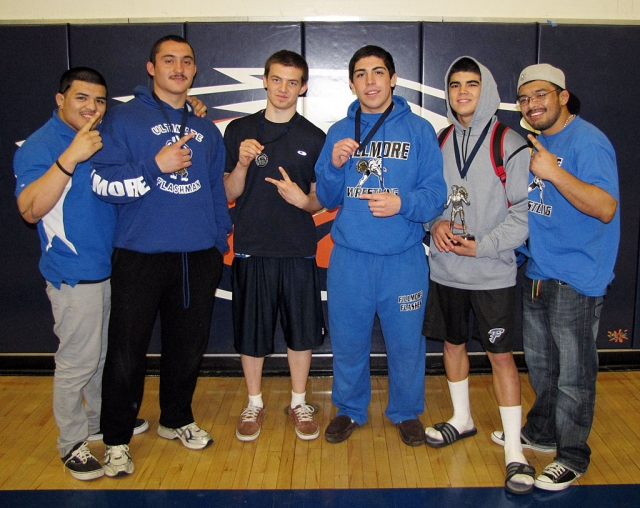 Varsity (l-r) Coach Froggy, Sammy Orozco 220lbs 1st place, Mark Zavala 145lbs 2nd place, Joseph DeLaMora 170lbs 1st place, Robert Bonilla 138lbs 1st place and Middle Weight MVP, and Coach Turtle.