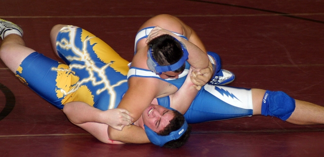 The wrestler above tries to avoid being pinned by Fillmore.
