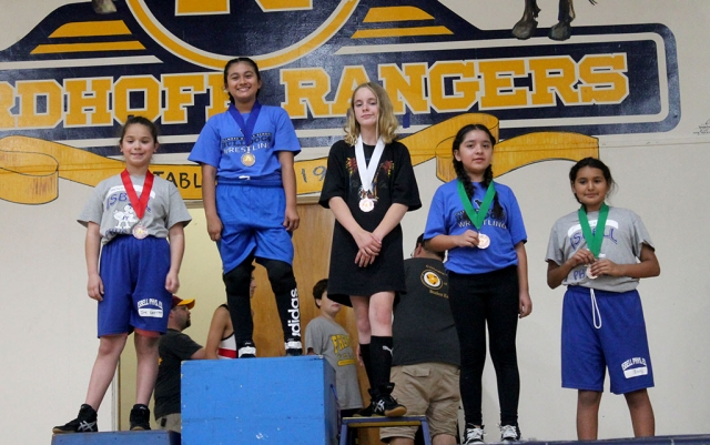 Pictured above is Fillmore Middle School's Emma Torres who took 1st in the 6th Grade Light Weight Girls Division and Alexa Martinez (far right) who took 4th in the 6th Grade Light Weight Girls Division at the Ventura County Middle School Wrestling Championship Tournament. Photos courtesy Coach Michael Torres. The Fillmore Middle School Wrestling Team concluded its season at the Ventura County Middle School Wrestling Championships at Nordhoff High School in Ojai. The championship was a tournament format where athletes are entered in brackets by age, grade level, and weight class. The eight county teams that competed represented middle schools from Balboa, De Anza, Fremont, Isbell, Matilija, Sinaloa, and Soria.  The Fillmore Bulldogs performed well on the mats. The results were as follows: Emma Torres: 1st Place -6th Grade- Light-weight girls (2-0 with two pins). Meya Garcia: 2nd Place- 8th Grade-Light-middleweight girls (1-1). Jonathan Patino: 3rd Place - 6th Grade- Upper-weight boys (1-1 with one pin). Devin Camacho: 4th Place 7th Grade-Feather-weight boys (0-2). Alexa Martinez: 4th Place -6th Grade-Light-weight girls (1-2 with one pin). Coach Michael Torres would like to thank the athletes' parents, Fillmore High School Wrestling Coaches Jorge Bonilla and Manuel Ponce, FHS Principal John Wilber, FMS Principal Pablo Leanos, FUSD Staff Sol Andrade, Lynn Cole, Tiffany Emhoff, April Mendez, and Priscilla Montero for their support in making the season a success.