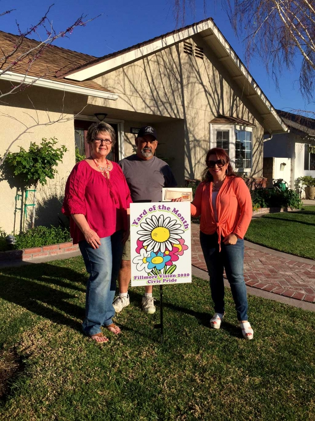Theresa Robledo presents Civic Pride Vision 20/20 Yard of the Month along with a generous gift Certificate from Otto &  Sons Nursery for $40 to Ray & Nancy Cervantez.