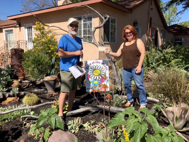 Dave and Jenna Miller were presented with a gift certificate from Otto & Sons Nursery for being Civic Pride Vision 20/20's Yard of the Month.