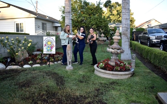 Fillmore Civic Pride/Vision 2020 announced their May 2019 Yard of the Month winner. Pictured left to right is Fillmore Civic Pride/Vision 2020's Ari Larson presenting Kassandra Quintero (holding Rocky) and friend Maria Felix (holding Riley). Photo Credit Nancy Alonzo.