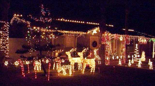 "Vision 2020 Civic Pride Committee December ""Holiday"" Yard of the Month award."