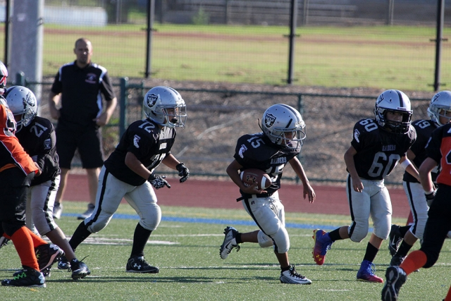 Raiders Bantam 15 runs for a first down. Photos courtesy Crystal Gurrola.
