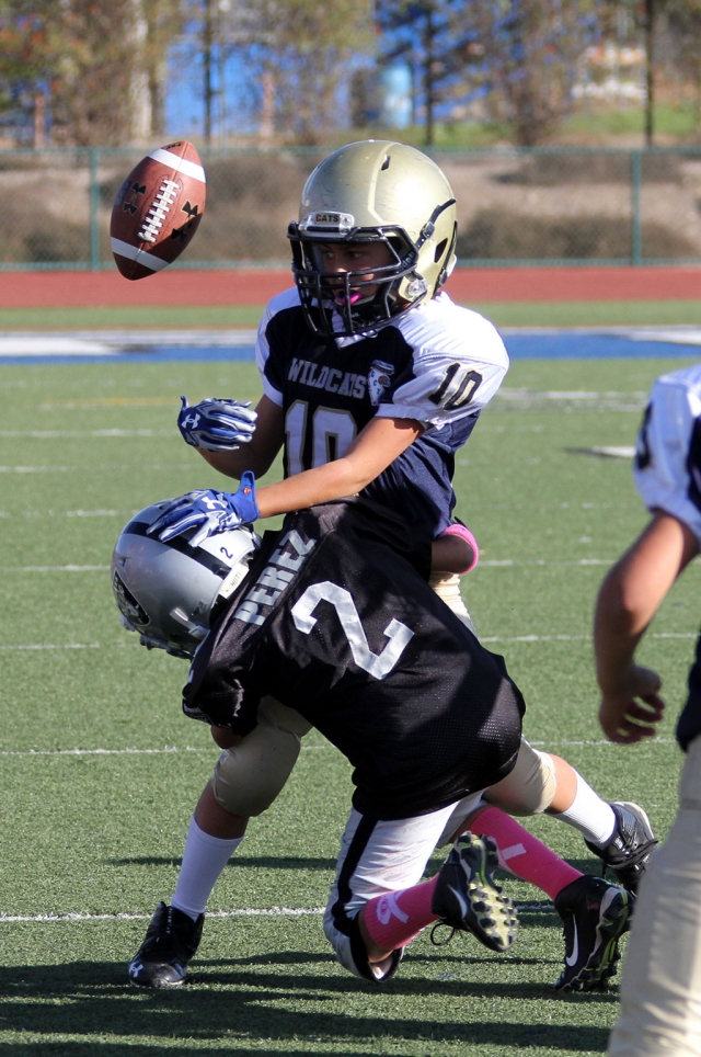 Raiders Bantam Black #2 Makes the tackle and causes a fumble. Photos courtesy Crystal Gurrola.