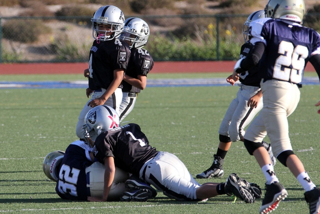 Raiders Bantam Black #1 makes a tackle
