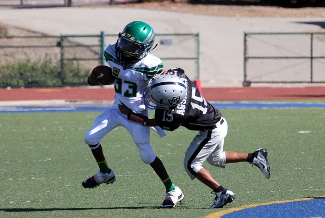 Raiders bantam silver #15 makes a tackle