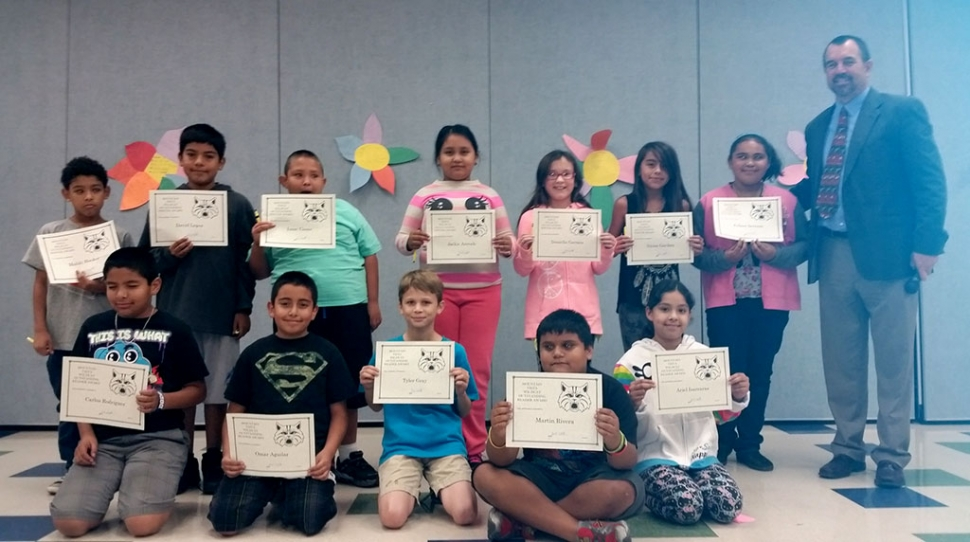 4th and 5th Graders Readers and Writers of the Month at Mountain Vista School. Pictured are Mahki Hooker, Carlos Rodriguez, David Lopez. Omar Aguilar, Isaac Casas, Martin Rivera, Jackie Arevalo, Tyler Gray, Daniella Garnica , Julissa Serrano , Nyssa Garibay, and Ariel Isarraras. Principal John Wilber pictured right.