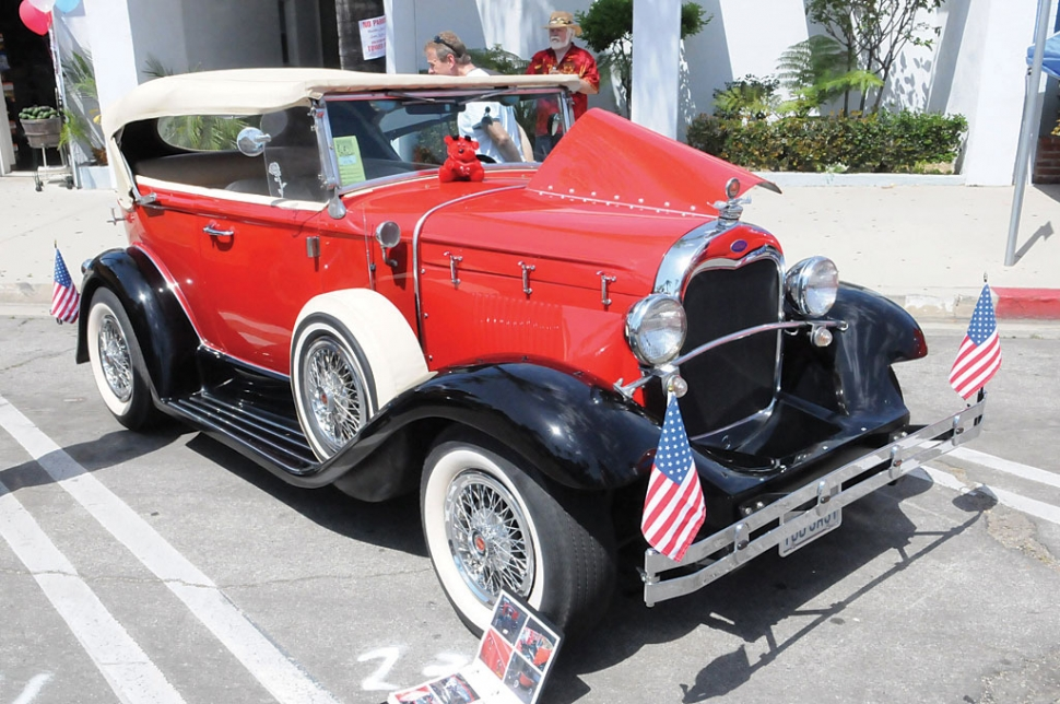 A big crowd turned out for this year's Fourth of July Chili Cook-Off and Car Show. The show featured hundreds of sparkling autos. (Above) A 1920's Ford in full glory.