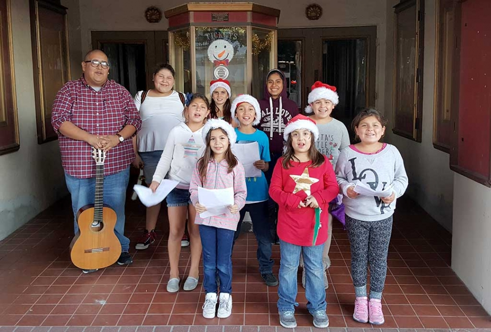 Friday afternoon a group of kids from the Boys & Girls Club got into the Christmas spirit, by singing Christmas Carols to the community in front of the Historic Fillmore Town Theatre.