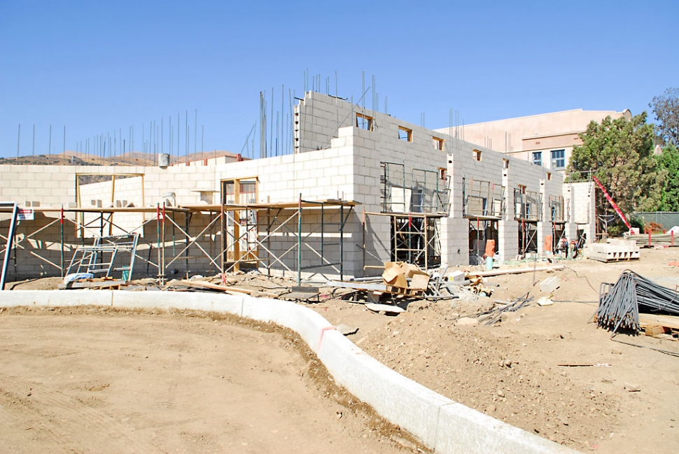 This photo shows the entrance way to the pool complex before being recently paved.
