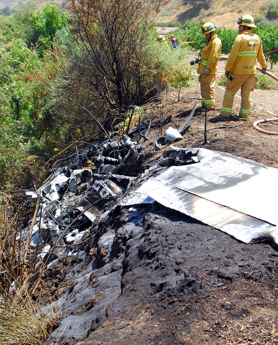 Fire crews remained on scene to extinguish several small brush fires ignited by the wreckage.
