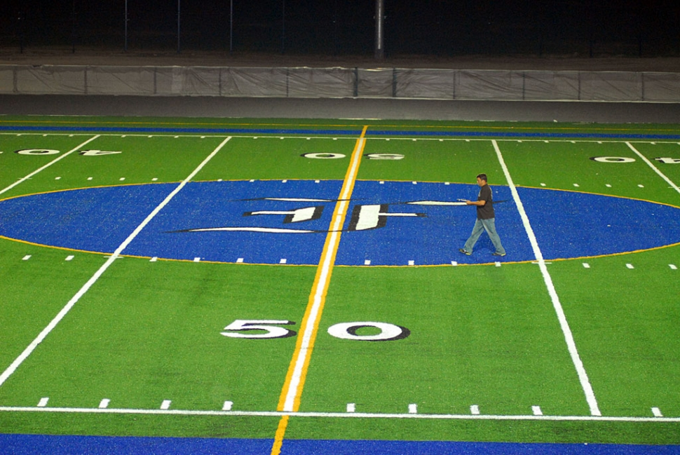 On Tuesday evening, the man above took light meter readings as he walked down the center of the new Fillmore High School football field. Photographers of night football and soccer games will be delighted with the greatly improved lighting environment.