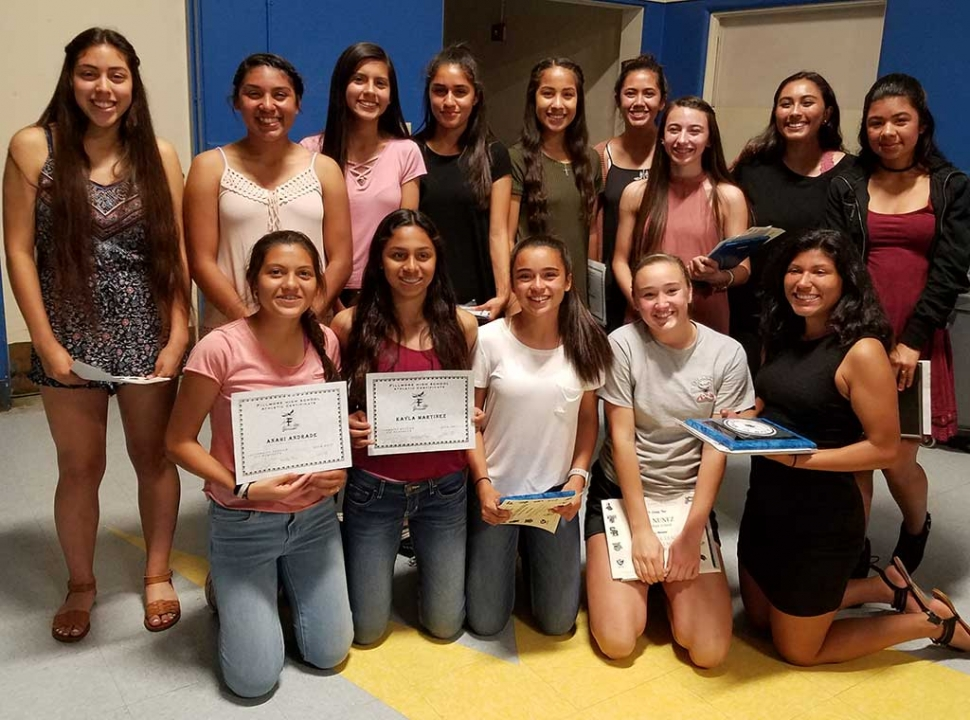 Fillmore High School Girls Soccer Team smile for a photo during their end of the year banquet, where they celebrated placing in their league this season.
