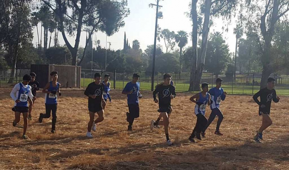 Flashes boys cross country team as they warm up before their race held in Riverside this past weekend.